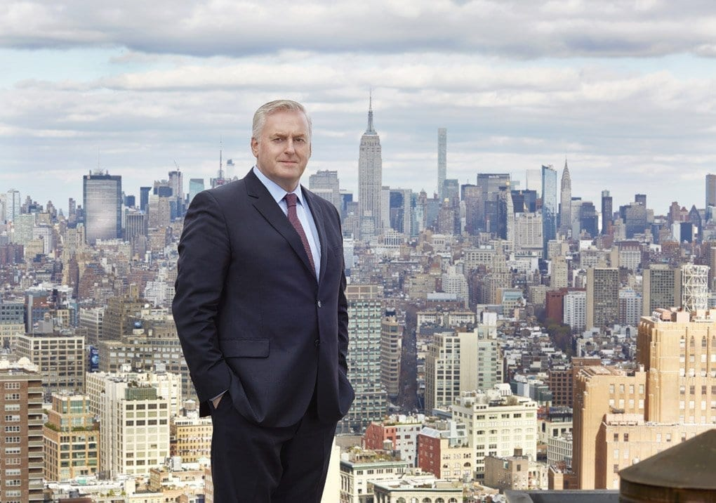 Sean Halpin, director of operations for J.T. Magen, dominates the foreground backed by panoramic views of New York City.